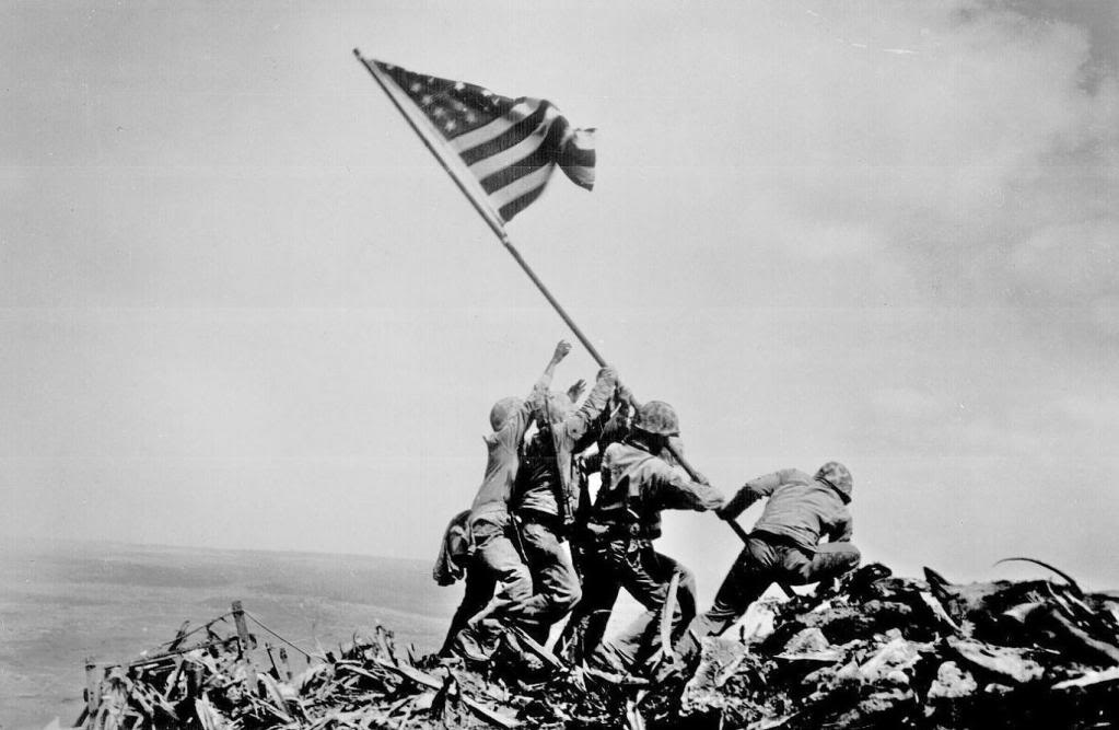 Pictures of Flag Raising at Iwo Jima during WWII staged
